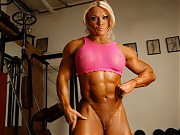 Bodybuilder Lisa Cross is naked in the gym, and as...