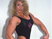 Denise Rutkowski has huge arms, chest, back, and k...