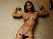Ariel strips in the bedroom, showing off her muscu...