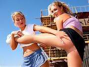 Two sports girls do outdoor pantyhose drills