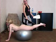 Juggy naked trainee exercises with a fitball