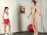 Busty gymnast exercised with a crop and a gag