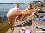 Two gymnasts in pantyhose working riverside